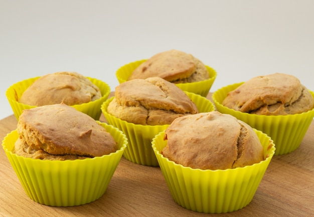 Banana muffins on a wooden board, natural light, close-up