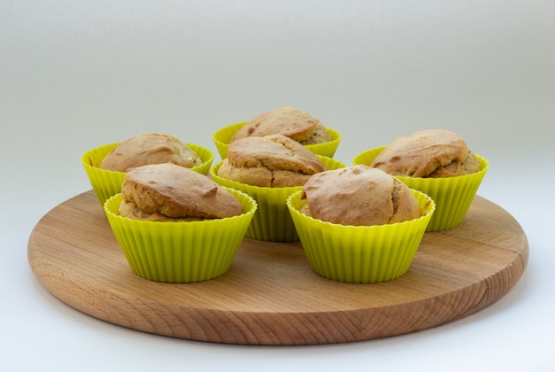Banana muffins on a wooden board, natural light