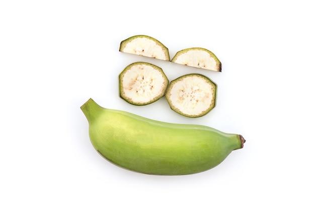 白い背景で隔離のバナナまたは栽培バナナの果実。上面図、フラットレイ。
