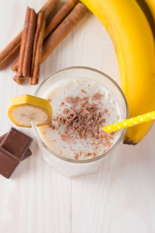 Banana smoothie on a wooden table.