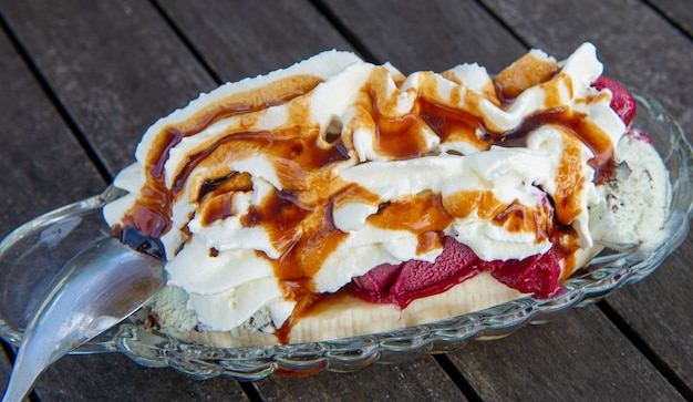 A banana split on the wooden table