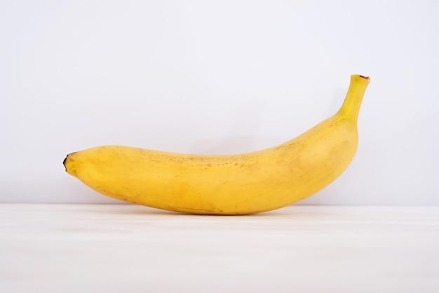 Banana on white wooden background