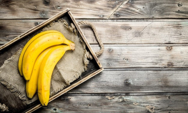 Bananas on the black old dressing. on a wooden.