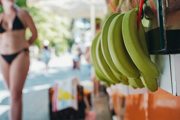 Bananas at the street farmers market fresh summer fruits for juice and smoothies summer vitamins hea...