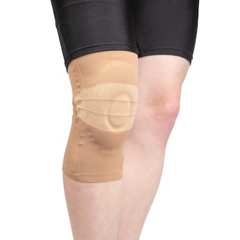 Bandage for fixing the injured knee of the human leg on a white