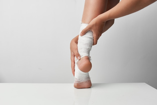 Bandaged leg injury health problems closeup