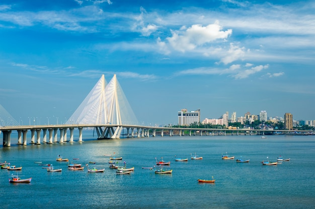 Bandra - worli sea link bridge with fishing boats view from bandra fort. mumbai, india