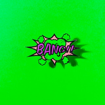 Bang text on explosion bubble pop art style against green backdrop