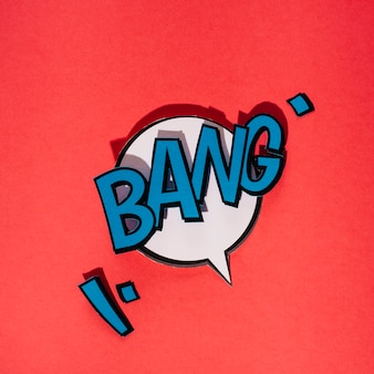 Bang text on white speech bubble pop art style against red background