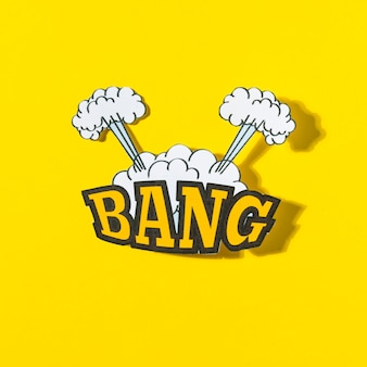 Bang text with explosion cloud in comic style against yellow background