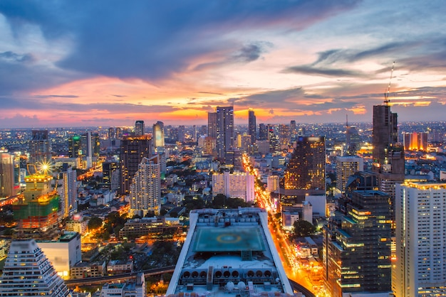 Bangkok city skyline aerial view at sunset with colorful clouds and skyscrapers of midtown bangkok.