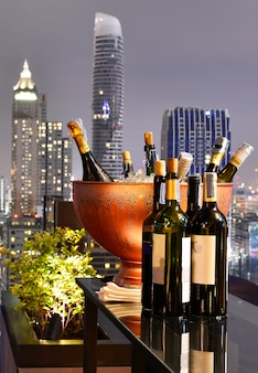 Bangkok city view point from rooftop bar with wine bottles