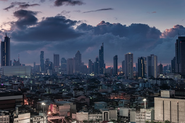 Bangkok city with high buildings in downtown and dramatic sky at dawn