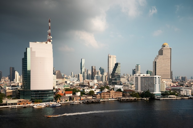 Bangkok city with office buildings in downtown near the chao phraya waterfront in thailand