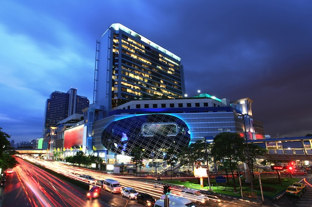 Bangkok famous and fashion shopping center building at night with traffic light trail