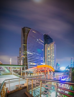 Bangkok - march 5 2017 : public skywalk with building architecture style modern of business area in bangkok. this place is very popular that tourists like to take photos of modern architecture