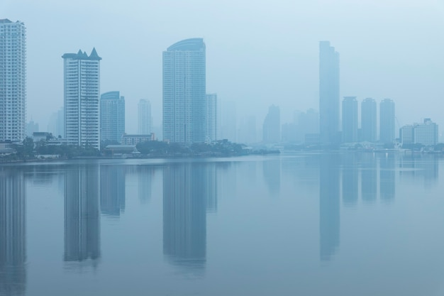 Bangkok office buildings and condominium with chao phraya river and chips. office building under smog in sathorn bangkok. smog pm 2.5 is a kind of air pollution. bangkok city in the air pollution.