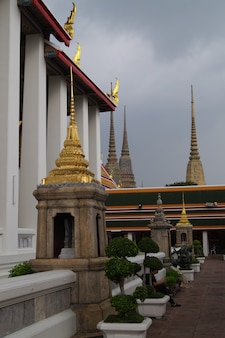 Bangkok temple colorful tiles flower pattern mosaic on pagoda landmark architecture . tiled pagoda, temple of dawn, temple of bangkok thailand