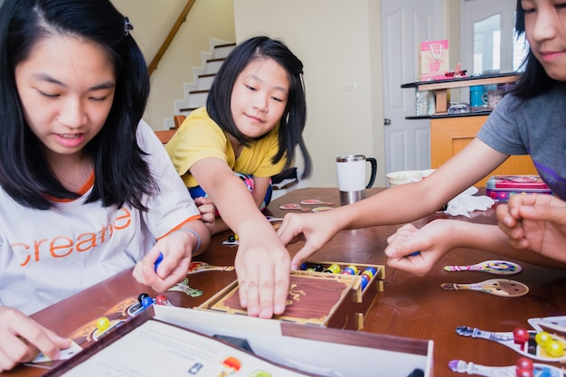 Bangkok thailand, 18 march 2018 : kids and parent playing board game indoor, family concept