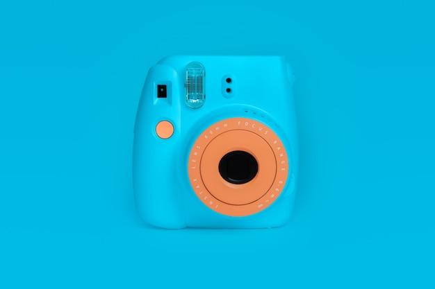 Bangkok, thailand - aug 05, 2021: polaroid camera fujifilm instax mini instant camera on blue color background.