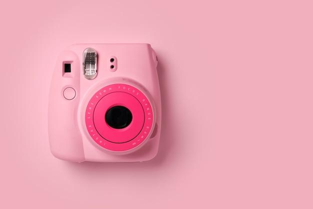 Bangkok, thailand - aug 05, 2021: polaroid camera fujifilm instax mini instant camera on pink background.