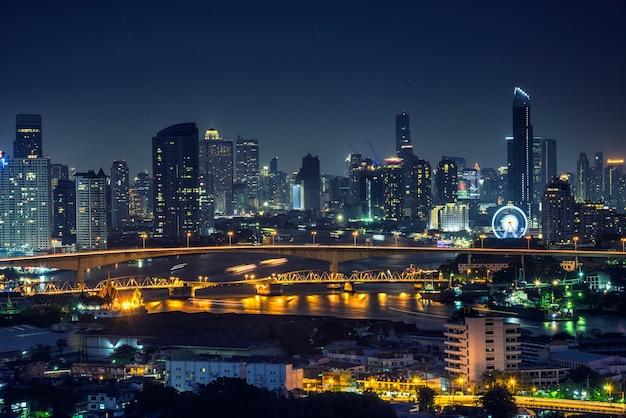 Bangkok thailand cityscape at night many tower near river