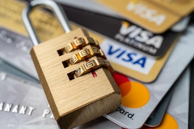 Bangkok, thailand - july 1, 2020 golden security digital password lock key on visa master card