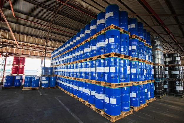 Bangkok, thailand - june 22th, 2019: blue oil barrels chemical drums vertical stacked up waiting for move