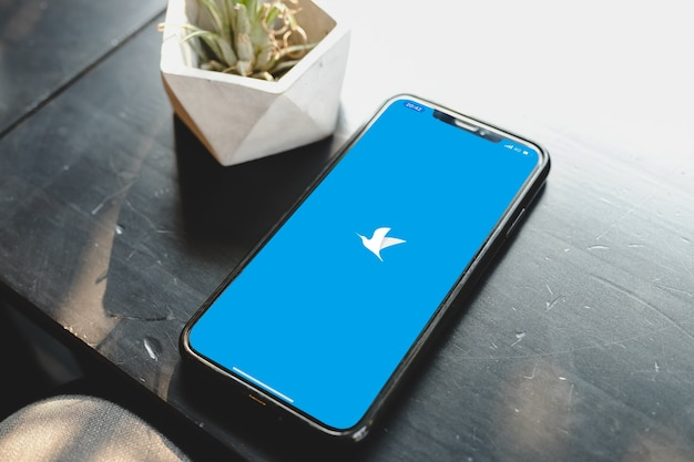 Bangkok. thailand. june 29,2020 :close up  smartphone on a table and start using twitter application.