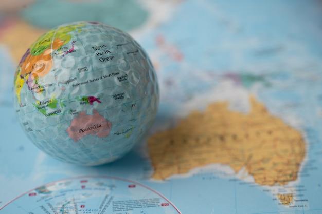 Bangkok, thailand, may 1, 2021 australia map at golf ball with flag on world globe map.