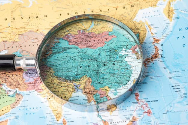Bangkok, thailand - november 01, 2020 china, magnifying glass close up with colorful world map