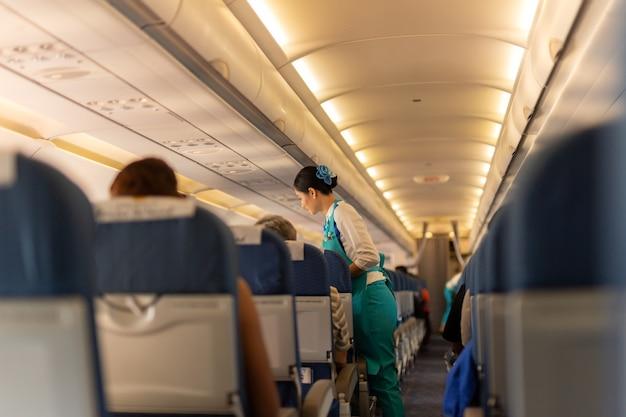 Bangkok, thailand - sep 27, 2018 - flight attendant serve food to passengers.