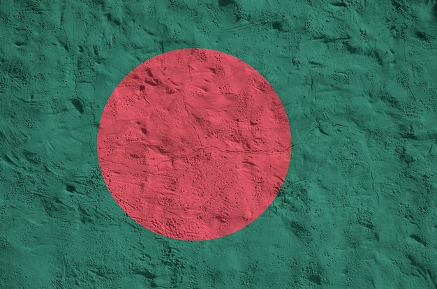 Bangladesh flag depicted in bright paint colors on old relief plastering background