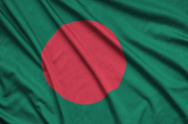 Bangladesh flag  is depicted on a sports cloth fabric with many folds.