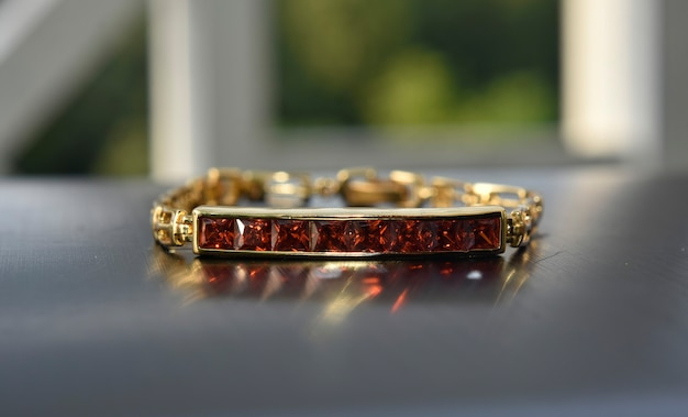A bangle gold with red ruby