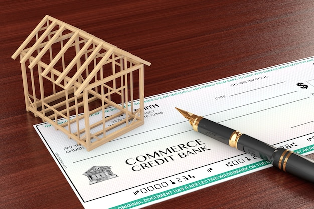 Bank check with house frame and pen on the table