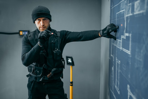 Bank robbery, male robber in black uniform