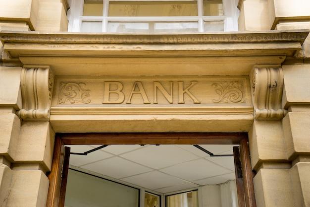 Bank sign logo stone background