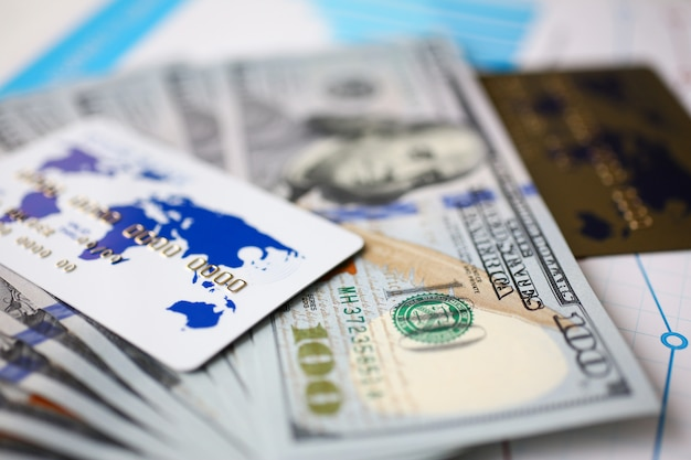 Banking cards lying on pile of us currency