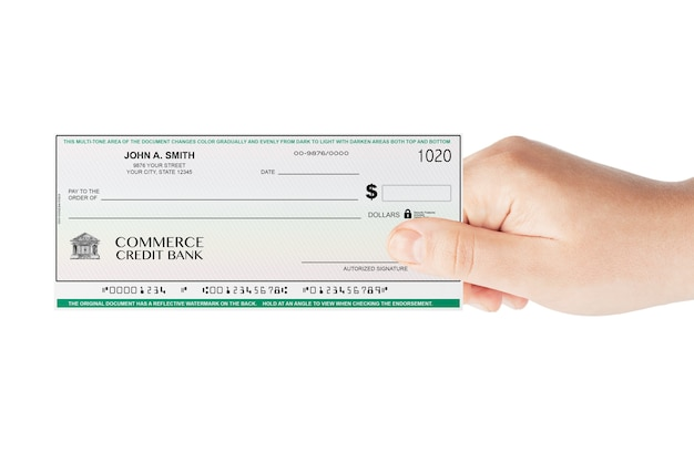 Banking check holded by hand on a white background
