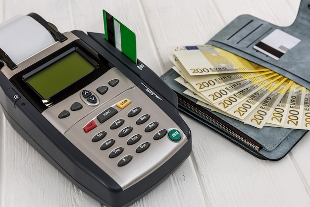 Banking terminal with euro in wallet and credit card