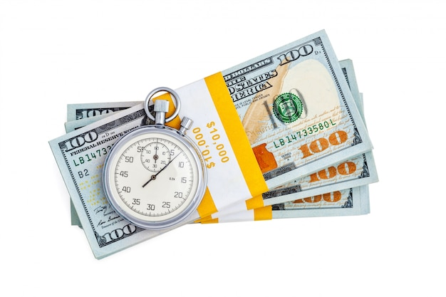 Banknotes of 100 us dollars with retro clock