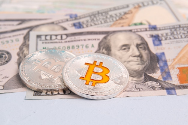 Banknotes of american dollars and cryptocurrency bitcoin