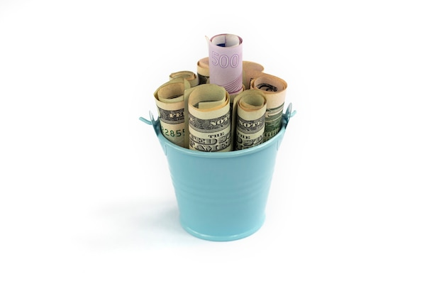 Banknotes in a bucket dollars and euros in little decorative blue