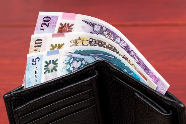 Banknotes of northern ireland in a black wallet