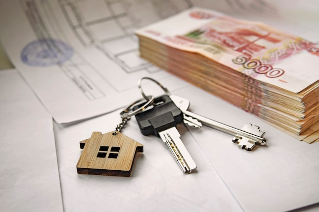 Banknotes of russian rubles and keys to the apartment. estate sale. the deal for the sale of the apartment. concept.