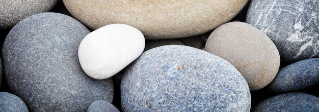 Banner abstract smooth round pebbles texture, spa concept