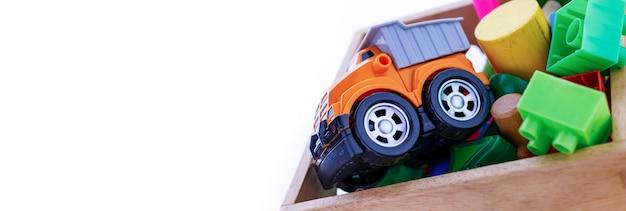 バナーの背景、白で隔離のおもちゃコレクション