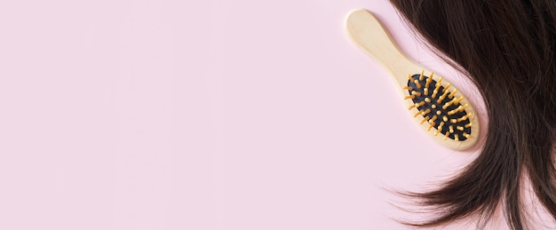 Banner of brunette straight hair and comb brush top view