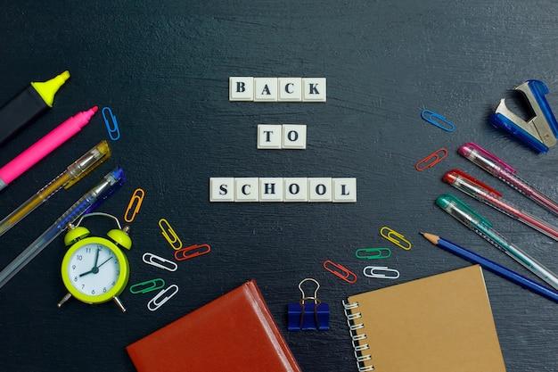Banner concept back to school on black blackboard